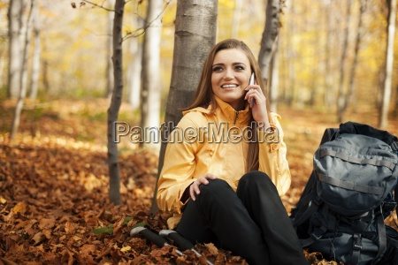 hiker woman resting and talking on