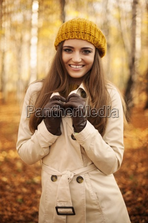 portrait of smiling woman at autumn