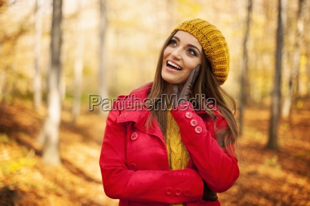 happy woman wearing fashion autumn clothes