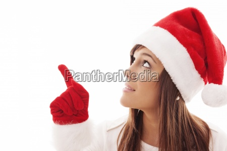 christmas woman pointing at copy space