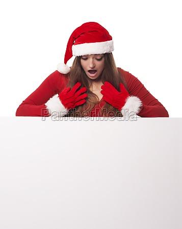 shocked santa woman looking down on