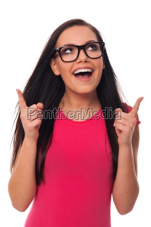 woman wearing glasses pointing at copy