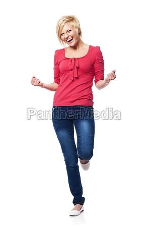 ecstatic beautiful woman celebrating