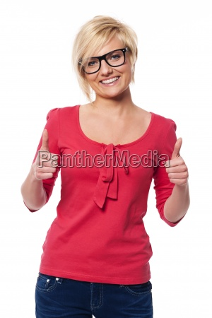 beautiful woman with glasses showing thumbs