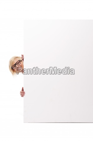 happy young woman peeking from behind