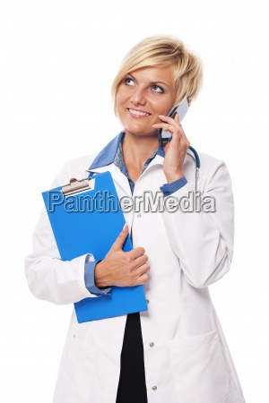 portrait of busy young female doctor