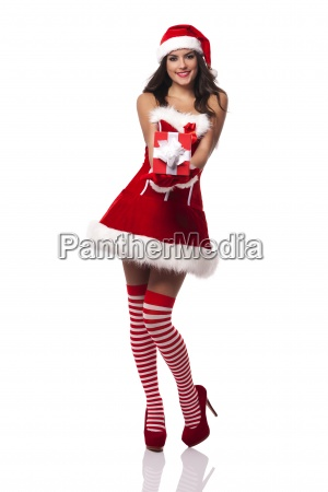 smiling santa claus woman giving red