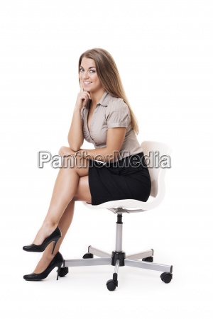 smiling woman sitting on office chair