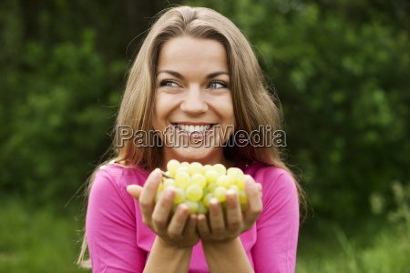 young woman with grapes