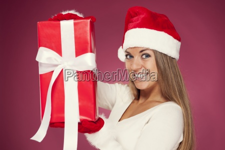 beautiful woman showing red present