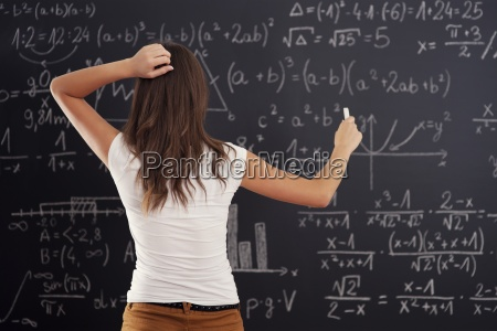 young woman looking at math problem