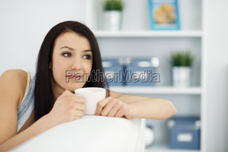 beautiful woman on couch with cup