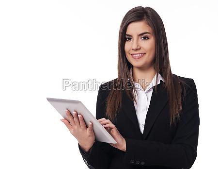 happy businesswoman using digital tablet