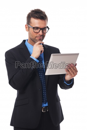 businessman working on his digital tablet