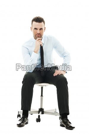 pensive businessman sitting on chair