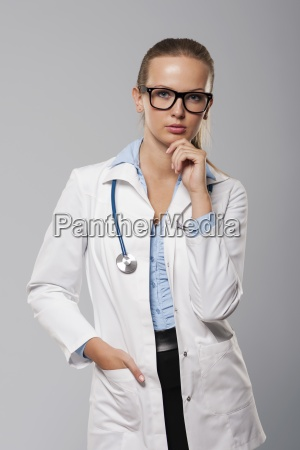 portrait of serious female doctor