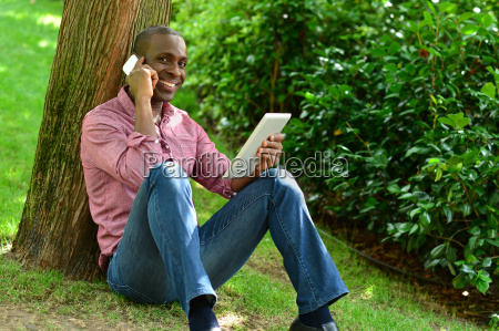 african man with smart phone and
