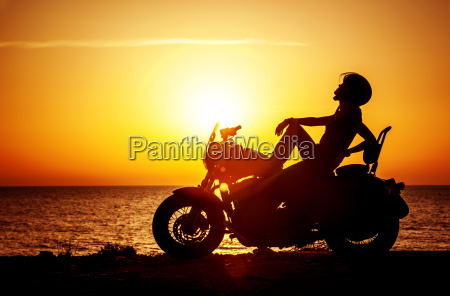 woman biker enjoying sunset