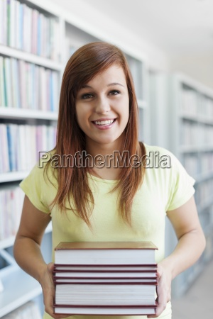 beautiful student holding a books in