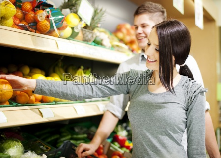 young couple shopping at groceries