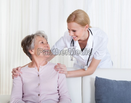 portrait of doctor and patient sitting