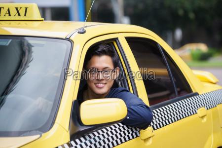 portrait taxi driver smile car driving