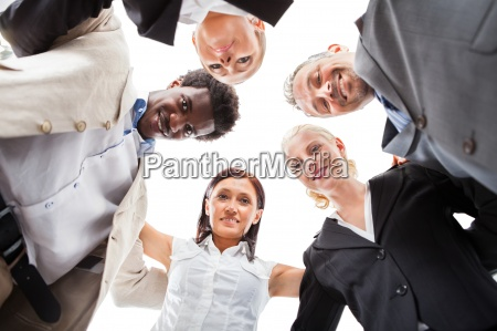 businesspeople making huddle