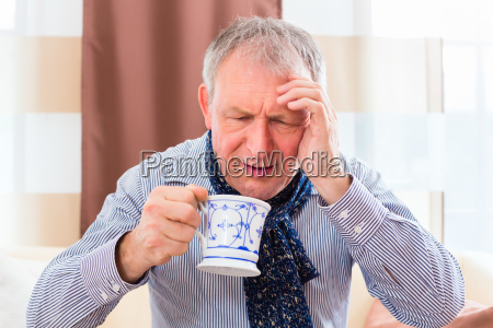 senior drinking tea and cure colds