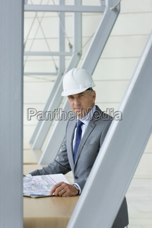 portrait of smiling architect with blueprint
