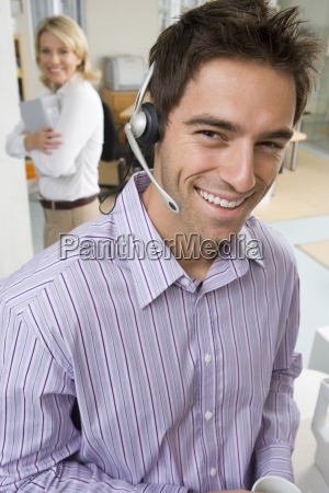 close up of businessman wearing headset