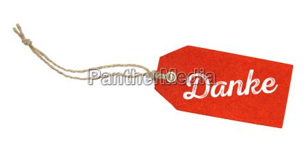 pendente vermelho com a inscricao obrigado