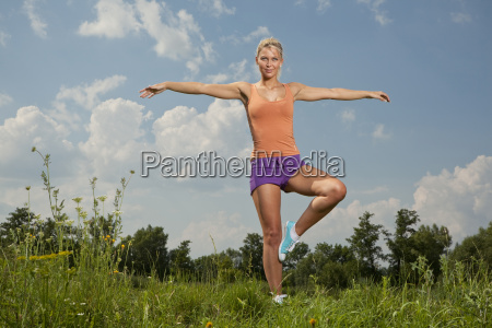 blonde girl in nature park fitness