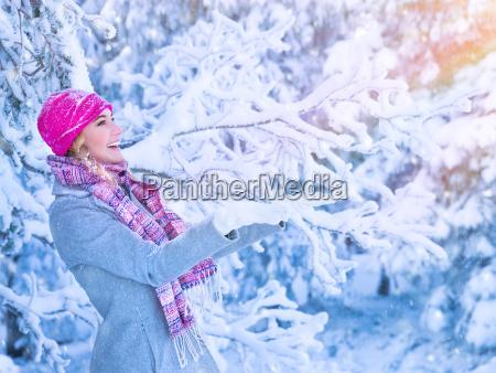 cute girl enjoying snow