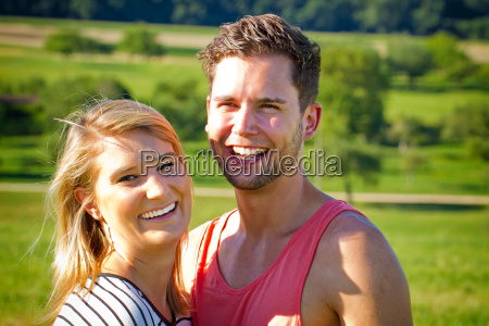 young happy couple outdoors in nature