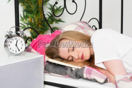 young woman has fallen asleep while