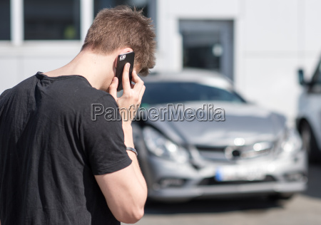 young man on the phone after