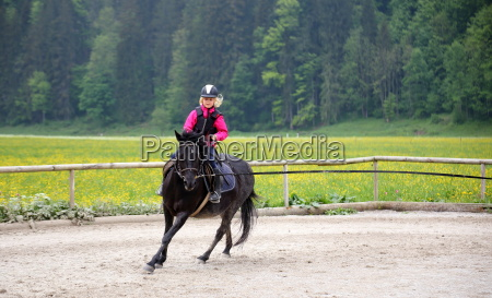 girl with horse gallops