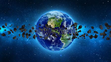 terra do planeta com asteroides no