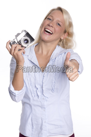 young woman holding an analog camera