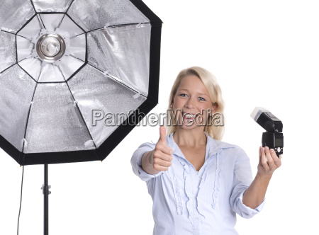 photographer with studio flash and compact