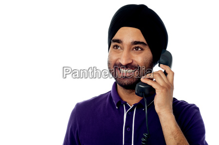 smiling indian man on the phone