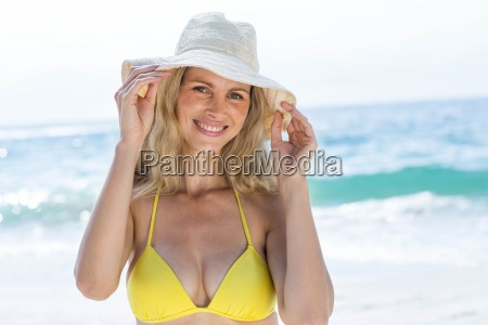 smiling pretty blonde in bikini looking