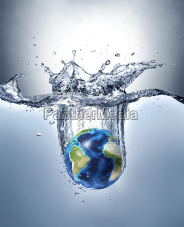 planeta terra espirrando na agua