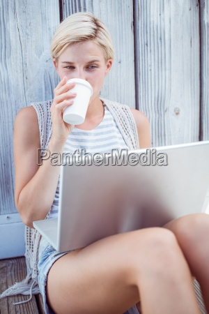 pretty blonde woman using her laptop