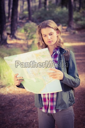 pretty blonde hiker reading map