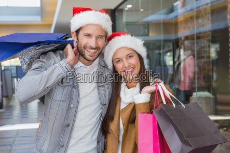 young happy couple holding shopping bags