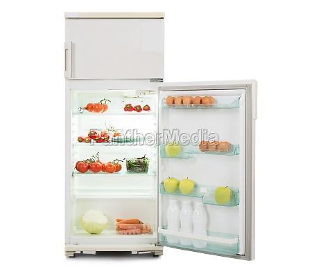 refrigerador aberto cheio de comida fresca