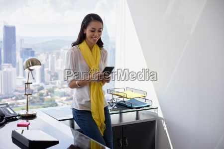 business woman text messaging on phone