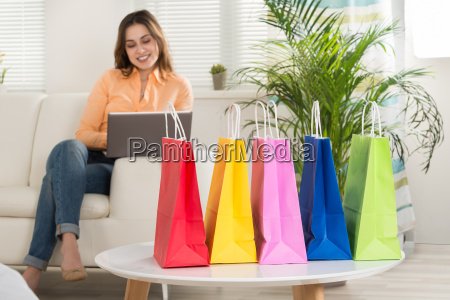 young woman shopping on laptop