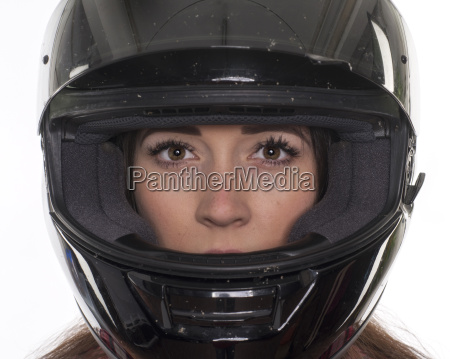 young woman with helmet in portrait